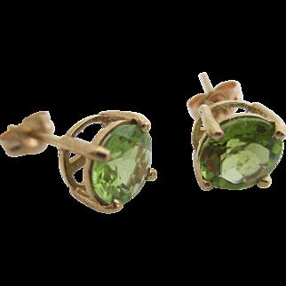 Ladies 14kt vintage peridot earrings.