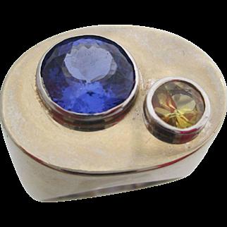 Gentlemans 14kt tanzanite and yellow sapphire ring.