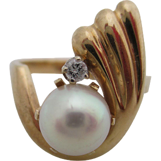 Ladies 14kt vintage cultured pearl and diamond ring.