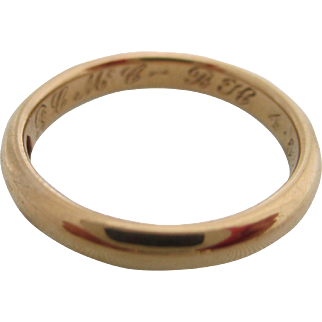 Ladies 18kt antique wedding band.
