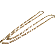 Unisex vintage 14kt figaro chain.