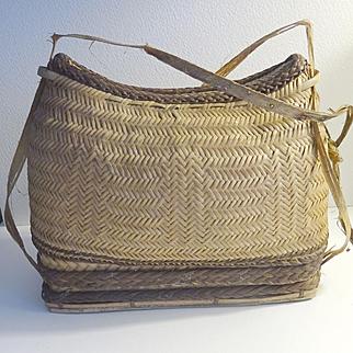 Intricately woven lidded basket