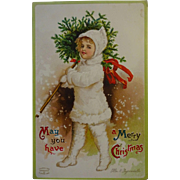 Signed Clapsaddle Postcard Child carrying Xmas Tree..sweet!