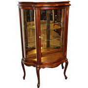Oak curio cabinet with serpentine glass c. 1890s