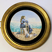 Antique hand painted porcelain plaque in a gold gilt frames with a girl watching the sea, ca 1920s-1930s