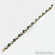 Antiques bracelet with cabochon of emerald, rose cut diamond and black enamel