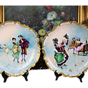 "Rare pair of 13.5'' Limoges France hand-painted plats/ chargers decorated the skating couples, artist signed ""Banazan"", 1920s"