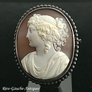Stunning high-relief caved large antique French cameo brooch with silver frame, 19th century