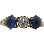 Antique .5CT Cushion Cut Diamond Ring with 1.75CTW of Cabochon Natural Sapphires