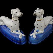 Pair Staffordshire Style Dalmatian Figurines on Blue Plinth - 20th Century