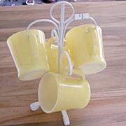 Yellow FireKing Mugs With White Rack