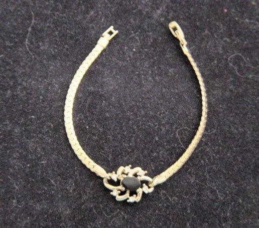 Dainty Polished Gold Metal With Black Center Stone And 6 Diamante Bracelet
