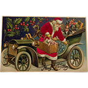 Early century Red Silk Suit Santa with Car Postcard