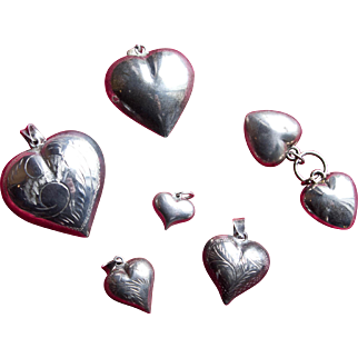 Collection of 7 Sterling Puffy Hearts