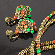 Hattie Carnegie Circa 1960's Red, Green, and Brown Bead in Antiqued Gold Tone Chandelier Earrings and Long Necklace
