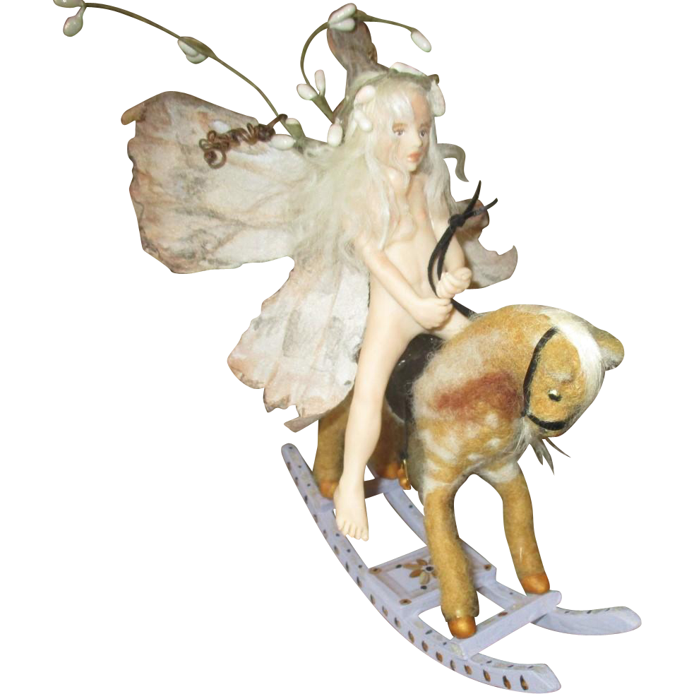 Captivating  sculpted Fairy on rocking horse OOAK