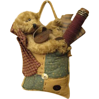 Adorable Teddy bear in old quilt bag