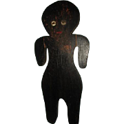 Black primitve wood boy