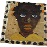 Adorable black child painting