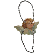 Great antique  die cut Angel with tinsel ornament