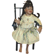 Sassy black bisque doll
