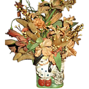 Flowers in kid vase