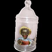 Adorable black boy on a apothacary jar