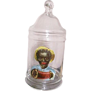 Adorable black boy on a apothacary jar