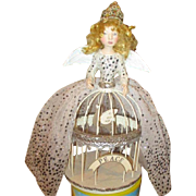 Enchanting Santos cage doll