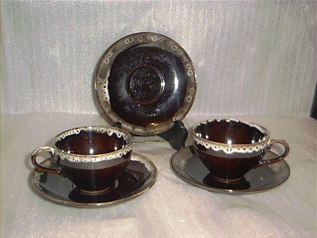 Japanese Red Ware Cups and Saucers
