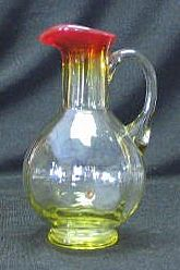 Small Paneled Red To Pale Honey Colored Pitcher