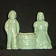 Matte Green Pottery Planter Of Boy And Girl Carrying Tub