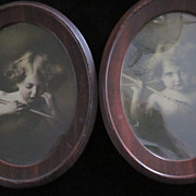 Cupid Awake, Cupid Asleep Sepia Tone Prints in Oval Metal Frames
