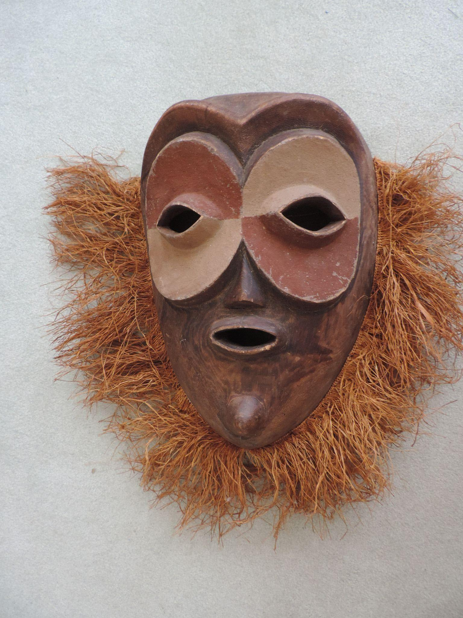 Large hand carved tribal mask with applied grass hair from