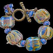Blue, Gold, Brass multi colored lamp work Bracelet