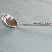 Repousse sterling silver mayonaise ladle