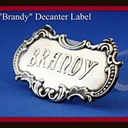 Liquor decanter label:  Brandy by Gorham sterling