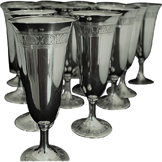 Champagne flutes for 16 in sterling
