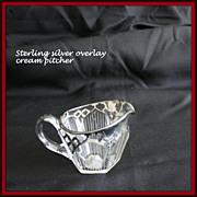 Sterling overlay cream pitcher with window pane designs