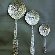 Repousse set of 3 sterling spoons with raised fruit in bowls