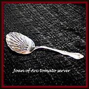 Joan of Arc tomato server in sterling by International Silver Co.