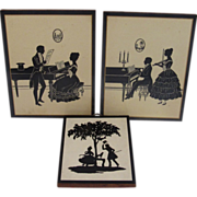 Three Vintage Laminated Silhouettes on Wood