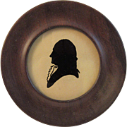Early paper Silhouette in Walnut Frame
