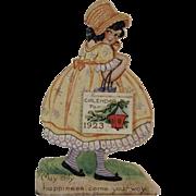 1923 Die Cut Calendar with Little Girl in Yellow Dress