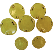 7 Yellow Glass Buttons with Gold Trim