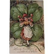 Girl with Huge Shamrock and Pink Flowers Embossed German Postcard Unused