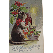 1910 Christmas Postcard Cat with Candle Snuffer Embossed Kitty