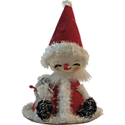 Large Flocked Santa with Painted Stocking Face 7.5 Inches Tall