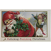 1915 Santa and Elf in Snowball Fight Embossed Postcard A Rollicking - Frolicking Christmas