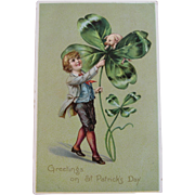 Tuck Boy with Pig in Four Leaf Clover Embossed St. Patrick's Day Postcard